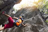 Man With  Backpack Climbing Rock Mountain,or Latin Man Backpack Climbing In Thailand Rock Mountain W poster