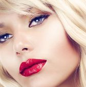 Beautiful Blond Woman Portrait close-up.Hairstyle.Makeup.Retro Style
