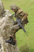 Armed Soldier Does Alpinism