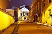 Picturesque Street And Gate Of Dawn At Night In Old Town Of Vilnius, Lithuania, Baltic States. The I poster