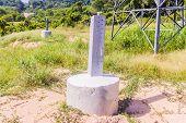 Construction Details: Round Stump Concrete Column With Galvanized Steel Leg Of The High Voltage Tran poster