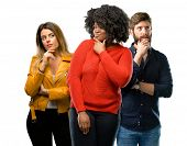 Group of three young men and women doubt expression, confuse and wonder concept, uncertain future poster