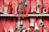 image of firehose  - Lapped fire hoses on a fire truck - JPG