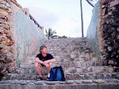 stock photo of bagpack  - Taking a brake in Holguin Cuba on a beautiful day - JPG