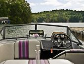 stock photo of ski boat  - A ski boat tied up at a dock showing the interior view - JPG