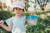 Cute Asain Girl Catching Butterfies With A Net And Holding A Box Of Insects, Outdoor Activity For Ki poster