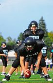 Youth American Football Center passes the ball