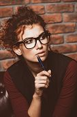 Portrait of a thoughtful business woman wearing glasses and formal clothes. Contemporary business. poster