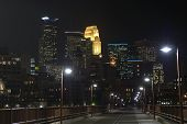 Minneapolis City Skyline At Night Looking Across The Stone Arch Bridge