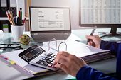 Businessperson Calculating Invoice poster