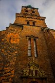 Copenhagen, Denmark: View Of The Landmark Green Spire Of The Former St. Nicholas Church, Now Nikolaj poster