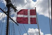 Danish Flag Close To Sailship