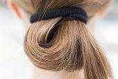 Close Up Of Blonde Fair Casual Hair Bun In Pony Tail, Macro poster