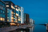 Oslo, Norway. Night View Embankment And Residential Multi-storey Houses In Aker Brygge District. Sum poster