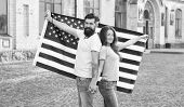 American Tradition. American Patriotic People. American Citizens Couple Usa Flag Outdoors. Patriotic poster