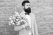 Romantic Gift. Macho Getting Ready Romantic Date. Tulips For Her. Man Well Groomed Tuxedo Bow Tie Ho poster