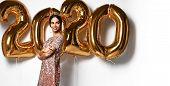 Beautiful Woman Celebrating New Year With Gold 2020 Balloons. Happy Gorgeous Girl In Stylish Sexy Pa poster