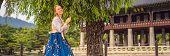 Young Caucasian Female Tourist In Hanbok National Korean Dress Travel To Korea Concept. National Kor poster