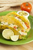 picture of tacos  - Homemade fresh fish tacos on a green plate - JPG