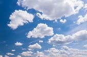 Cumulus Clouds And A Blue Sky