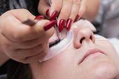 Eyelash Extension Master Long Eyelashes Beautiful Girl In A Beauty Salon. Eyelash Extension Procedur poster