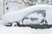 Snow-covered Machine. Car Under The Snow. Lots Of Snow And Big Snowdrifts On The Street. Vehicles Ar poster