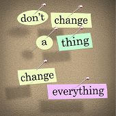 An advice or quote on paper notes pinned to a cork noteboard - Don't Change a Thing, Change Everythi