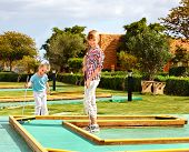 pic of miniature golf  - Children playing in golf - JPG