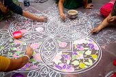 Hands Of Girls Making Rangoli - Indian Mandala. Indian Tourism. Indian Traditional Culture, Art And  poster