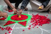 Hands Of Mans Making Rangoli - Indian Flower Mandala. Indian Tourism. Indian Traditional Culture, Ar poster