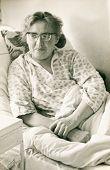 Vintage photo of bedridden woman (sixties)