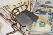 On American Dollars Are Army Medallions. Concept: Payment For Military Operations, Financing Of Mili poster
