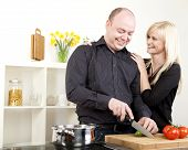 Affectionate Couple Preparing Dinner