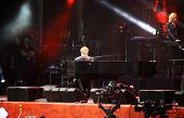 Singer Sir Elton John Performs Onstage