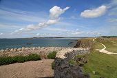 picture of anglesey  - Ynys Llanddwyn or Llanddwyn Island is a small tidal island off the west coast of Anglesey, North Wales. The nearest town is Newborough.