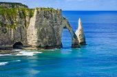 Etretat Aval Cliff And Rocks Landmark And Blue Ocean . Normandy, France. poster