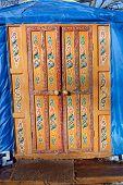 picture of yurt  - Wooden decorated orange door in kazakh yurt - JPG