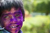 Young boy with face painted in Holi festival in India