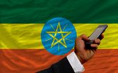 Cell Phone In Front  National Flag Of Ethiopia