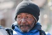 stock photo of hobo  - Closeup of homeless african american man - JPG