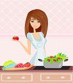 Bela jovem cozinhar alimentos de Concept.vegetarian de Vegetables.dieting fresco