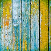 stock photo of wooden fence  - Old wooden planks painted with paint cracked by a rustic background - JPG