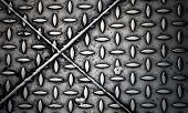 Closeup Texture Of Diamond Steel Plate With Perpendicular Crossing Joints