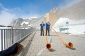 LUCERN, SWITZERLAND - APRIL 10 : Unidentified musicians are playing music with Alpine horns at Pilat