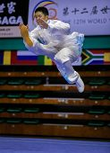KUALA LUMPUR - NOV 03: Jonathan Leung of Canada shows his taiji quan martial arts moves in the 'taiji quan' event at the 12th World Wushu Championship on November 03, 2013 in Kuala Lumpur, Malaysia.