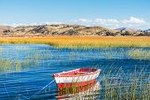 picture of andes  - boat in Titicaca Lake in the peruvian Andes at Puno Peru - JPG