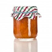Cloudberry jam in glass jar isolated on white background