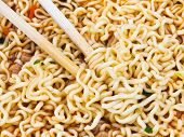Eating Instant Noodles By Wooden Chopsticks