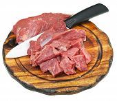 Cut Raw Meat And Ceramic Knife On Cutting Board