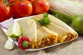 image of mexican  - Mexican tamale wrapped in corn husk served on plate - JPG